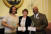 Second Place winner, Ms. Stephanie Smith; Ms. Diane Dimkoff, NARA Director, Customer Services Division; and the First Place winner. (Photograph provided courtesy of NARA).