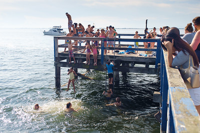 Kids jumping off the pier at Crescent Beach.