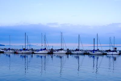 Sailboats moored at White Rock Pier.