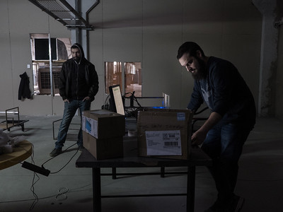 """Bitcoin miner Shota Siradze checking if his mining units have come online and are """"hashing"""" correctly, i.e. doing their job. Tbilisi, Republic of Georgia. Photo: Joe Harrison."""