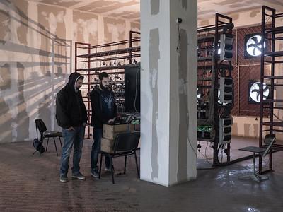 Bitcoin miner Shota Siradze and his business partner, Irakali J. Pruidze, use a laptop to monitor their mining operation. Tbilisi, Republic of Georgia. Photo: Joe Harrison.
