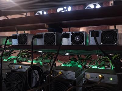 Bitcoin mining units glowing in action. Tbilisi, Republic of Georgia. Photo: Joe Harrison.