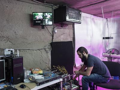 Bitcoin miner Shota Siradze repairing malfunctioning mining equipment in his office. Tbilisi, Republic of Georgia. Photo: Joe Harrison.