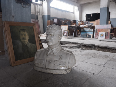 A painting and a bust of Joseph Stalin in storage at a cognac factory which houses one of bitcoin miner Shota Siradze's mining operations. Tbilisi, Republic of Georgia. Photo: Joe Harrison.