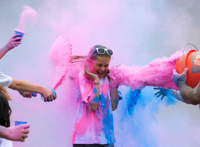 Nadav Soroker/Times-Georgian<br /> <br /> Spectators and runners pour powder over Lauren Rooks as she finishes the race during Oak Mountain Academy's end-of-year color run festivities, on Wednesday, May 15, 2019.