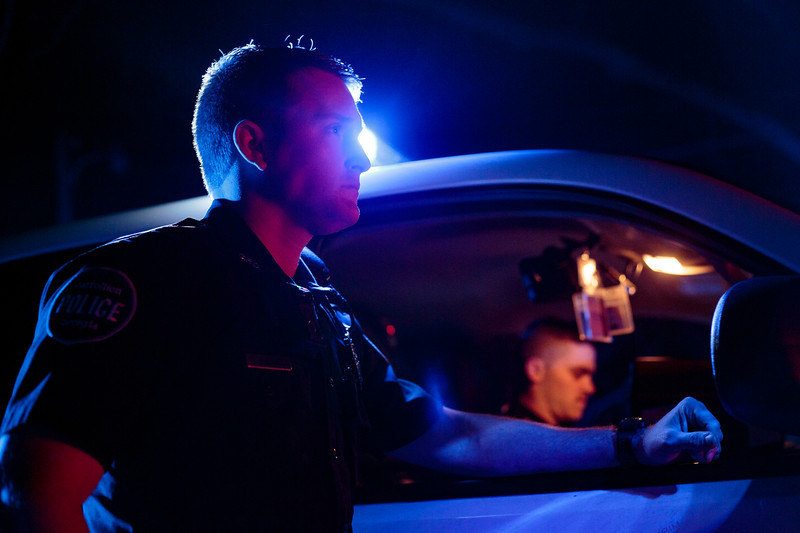 Nadav Soroker/Times-Georgian<br /> <br /> Carrollton Police Officer Nick Klein rests along a car during a traffic stop on the night-shift from Friday night to Saturday morning, on Friday, March 22, 2019.