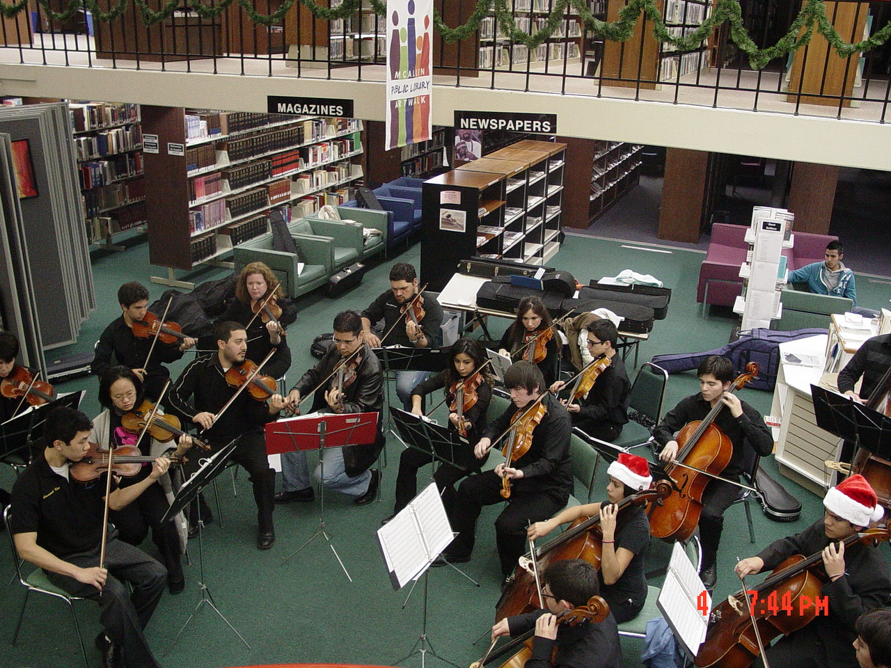 "The McAllen Memorial H.S. Chamber Orchestra performing their first tune that night at ArtWalk.<br /> <br /> McAllen Memorial High School Chamber Orchestra<br /> McAllen, TX<br /> 956-632-5201<br />  <a href=""http://memorial.mcallenisd.org/"">http://memorial.mcallenisd.org/</a>"