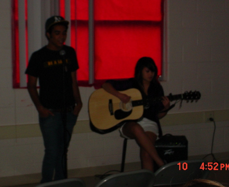 Teen participants, Nathaniel (left) and Angeli (right), performing in the talent show.