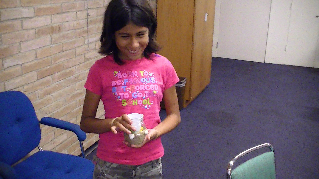 Teens decorating at the eco craft program held at the Main library.