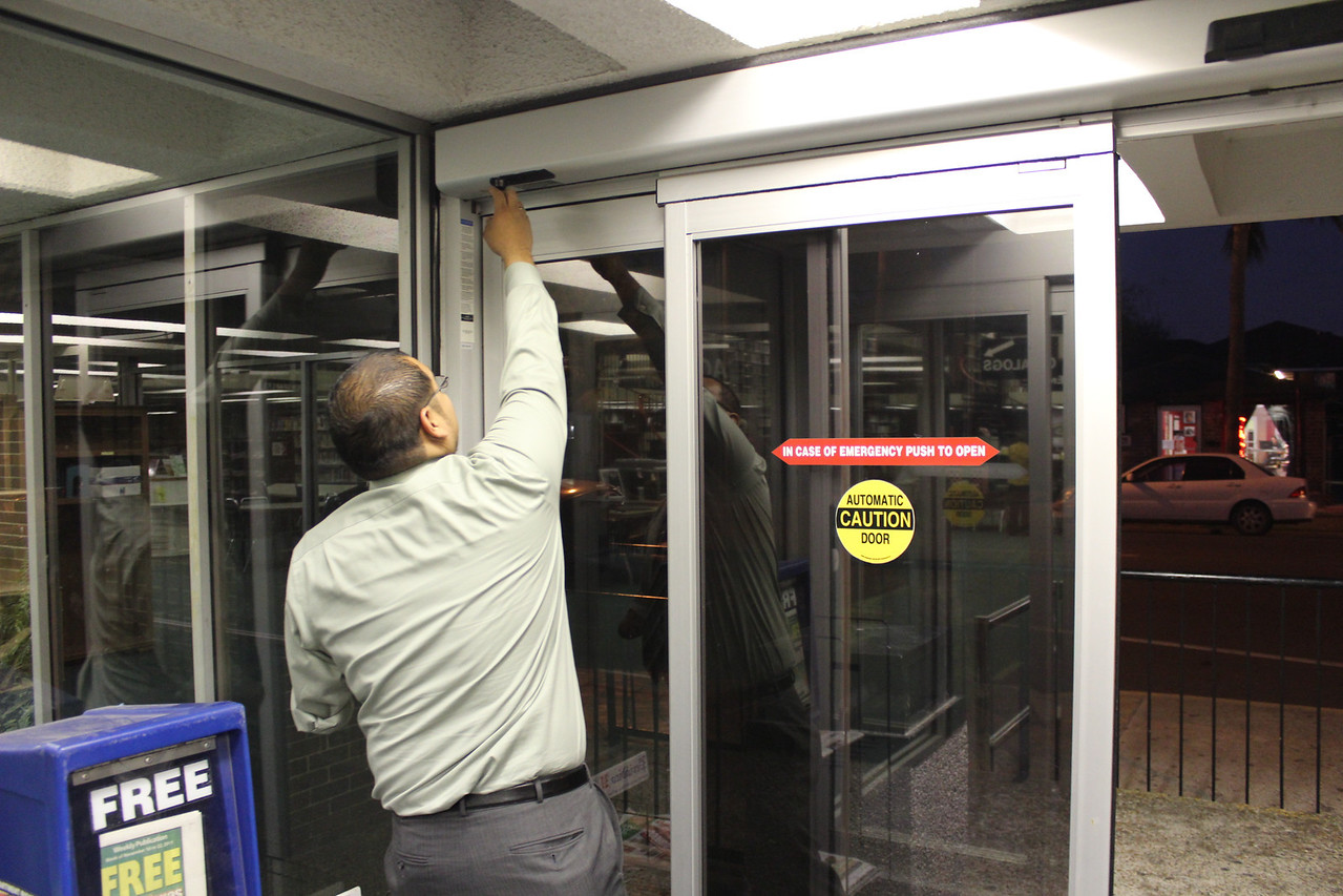 Loan Desk Assistant Victor Perez closes the doors for the last time.