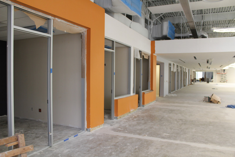 A line of public study rooms, extending to the teen area.