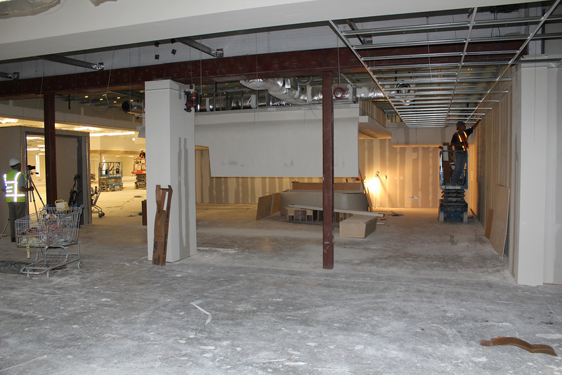 Inside the teen area, facing what will be the teen service desk and just beyond it, underneath a custom made canopy, the teen lounge.