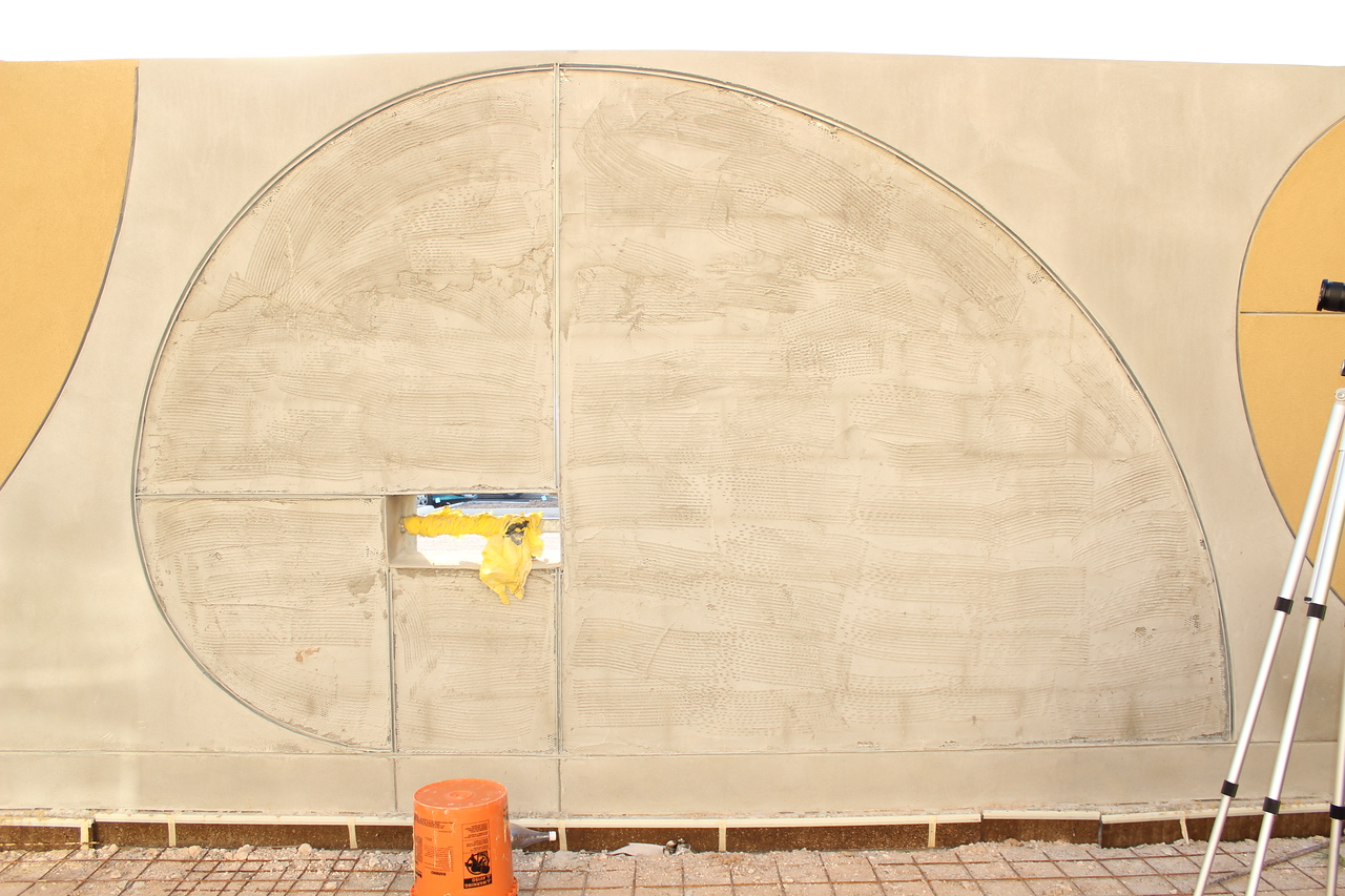 A shape on the interior wall of the outdoor children's area. It will be artistically enhanced with decorative glass in the weeks to come.