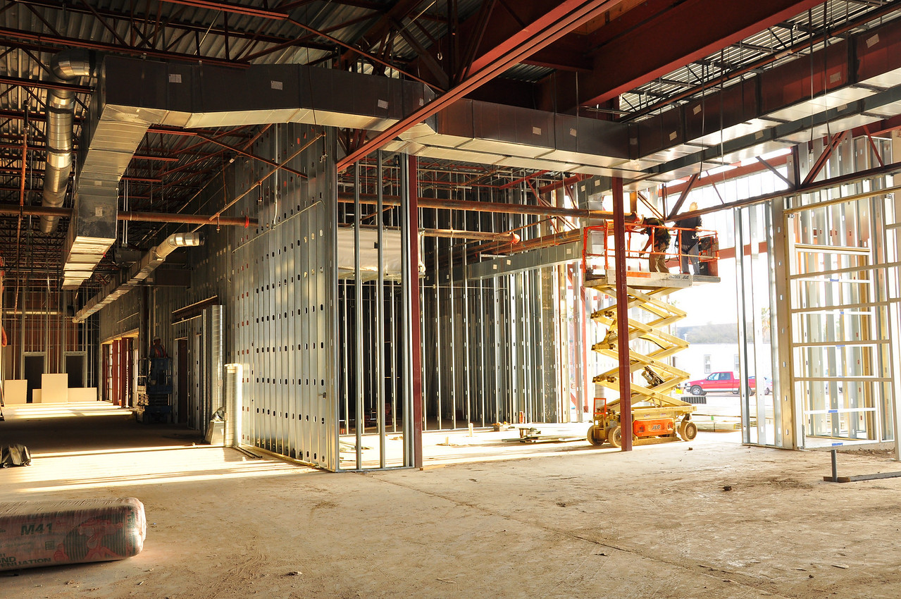 Front entrance. At left: hallway to auditorium and meeting rooms. At right foreground: framework for the cafe.