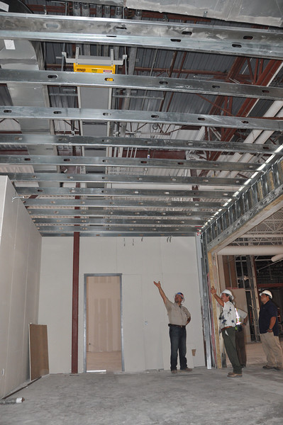 Ceiling framework. The yellow brace marks the path of the materials handling system, an automated conveyor belt that will run from the drive-up book drop to the circulation department, where returned materials will be automatically checked in and sorted for re-shelving.