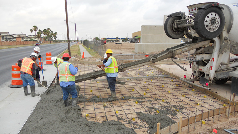 Laying the groundwork for the parking entrance facing Nolana Ave.