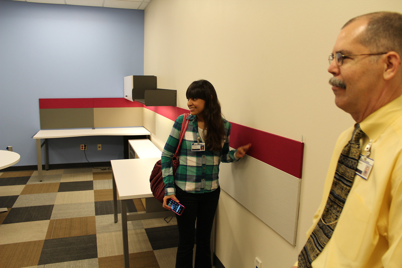 Marketing staffer, Sara Montoya, and Librarian Don Egle check out the Marketing workroom.