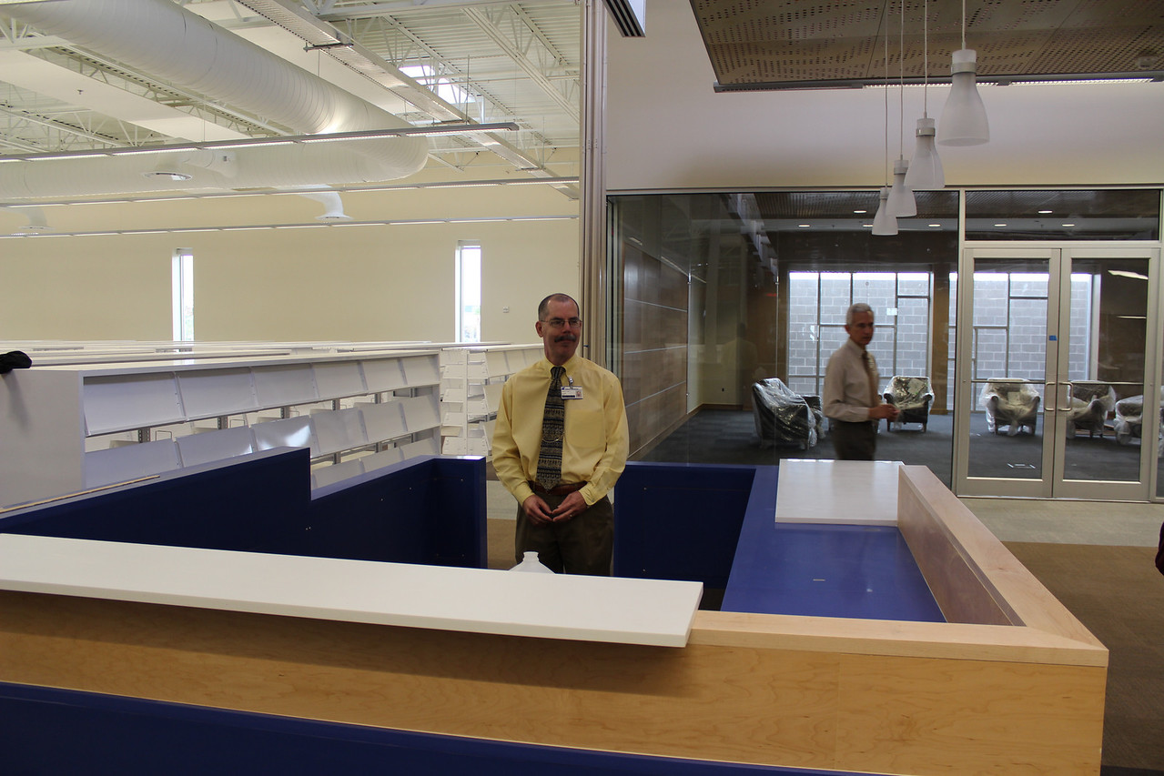 Librarian Don Egle in an information desk.