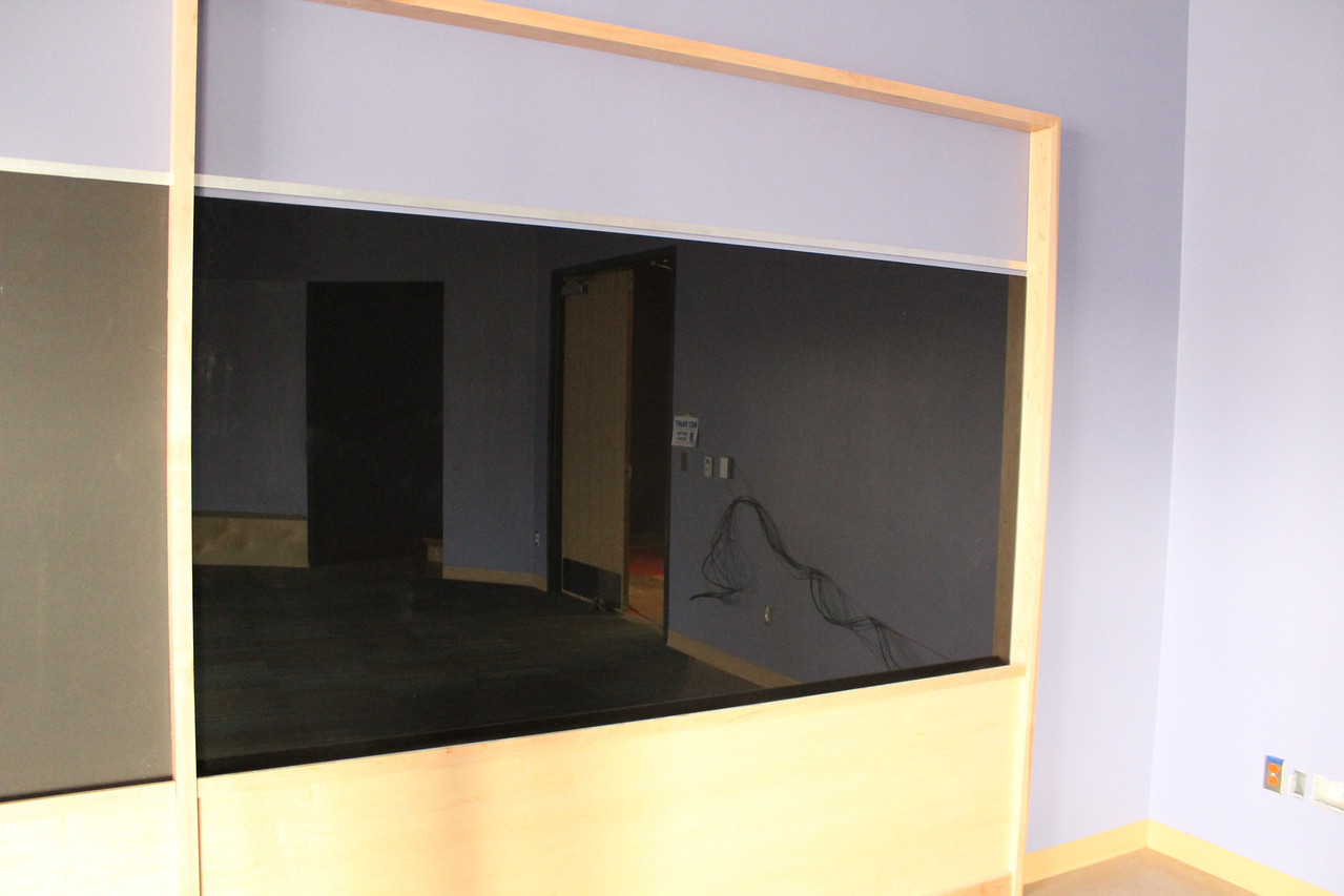 Children's program room. The shiny black surface is a dry erase board, where kids and program presenters can draw and doodle.