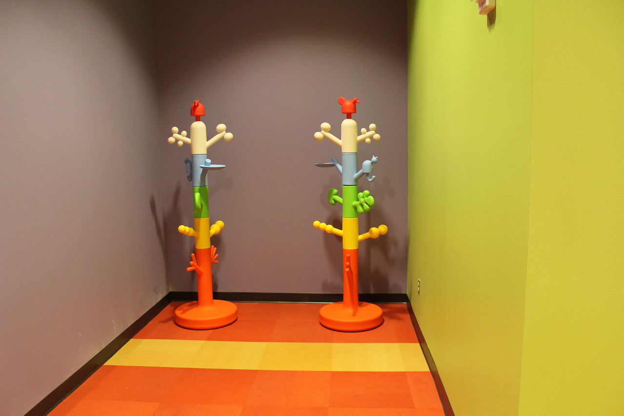 Coat racks outside Program Room in the children's section.