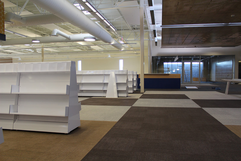 Shelves for the new arrivals section, leading to the north (blue) info desk.
