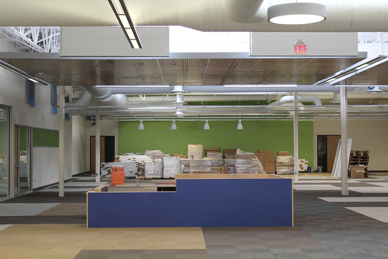 looking north, facing the north (blue) info desk and, beyond that, the electronic classrooms' doors (bracketing green wall)