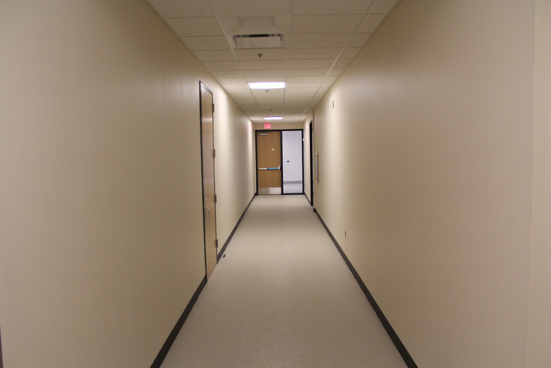 staff corridor leading to public meeting room corridor