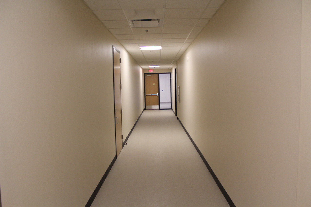 staff corridor leading to public meeting room corridor