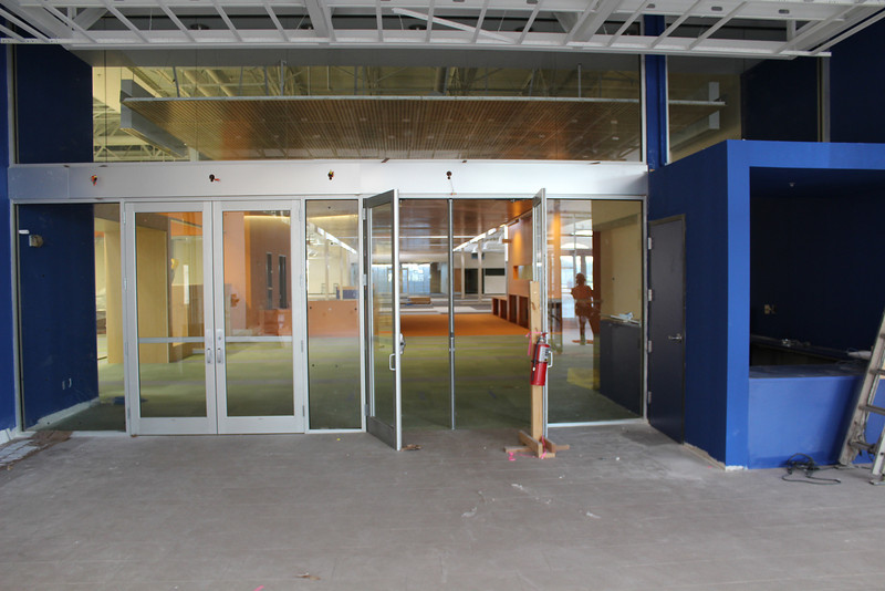 entrance to library part of the building, welcome desk at right