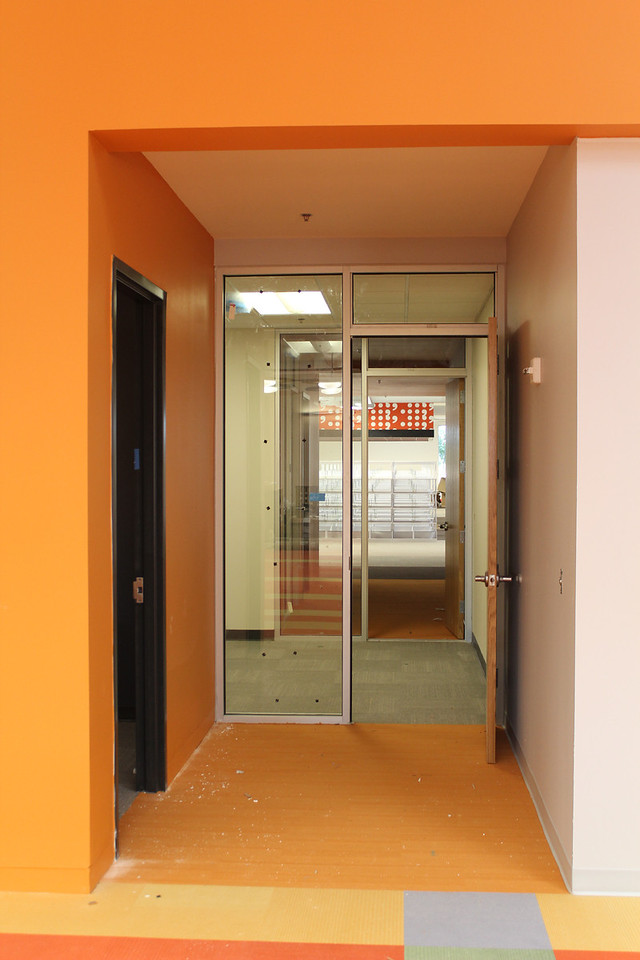 passageway from children's section to adult section of library. passage runs through a study room.