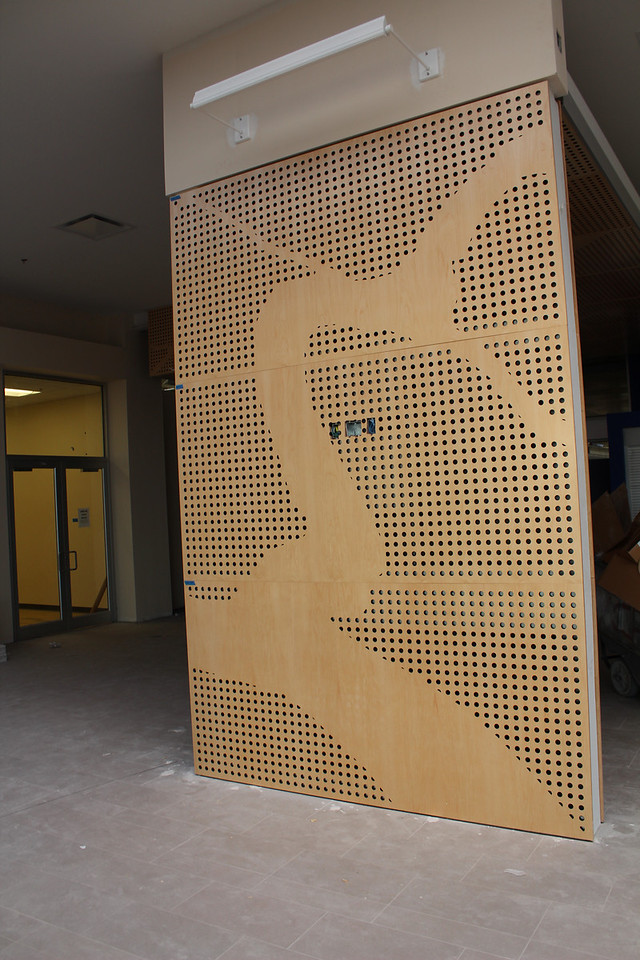 custom-made paneling in the lobby. A flat screen TV will be mounted here to display images and video.