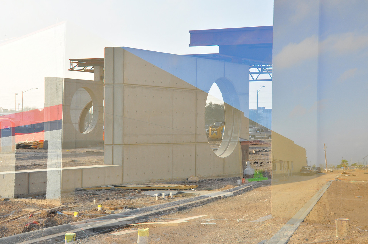 A double exposure of the east (front) and north (book drop) sides of the building.