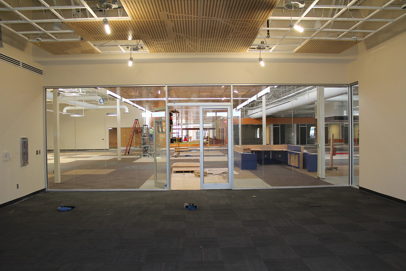 Inside the quiet reading room. Beyond it is the north reference desk and the path leading to the loan desk, public computer lab and children's section at the front of the library.