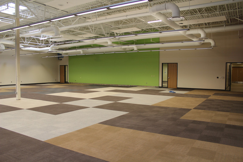 The space that will soon be occupied by the genealogy and audiovisual collections. The two doors bracketing the green wall are electronic classrooms.