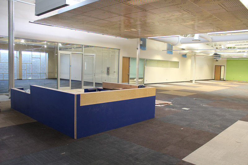 North reference desk, quiet reading room, door to reference staff workroom, and door to one of the electronic classrooms (far right, next to the green wall).