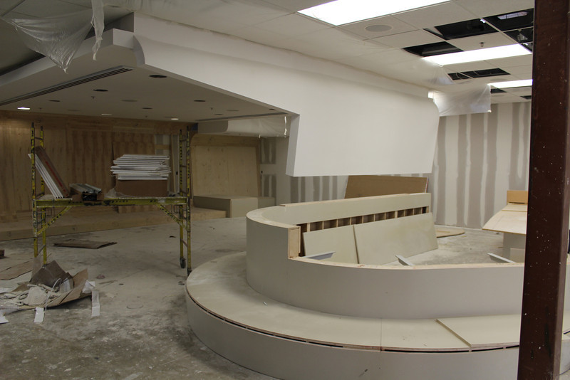 Teen service desk. The desk is a shapely feature integrated with the design of the teen lounge (to the left).