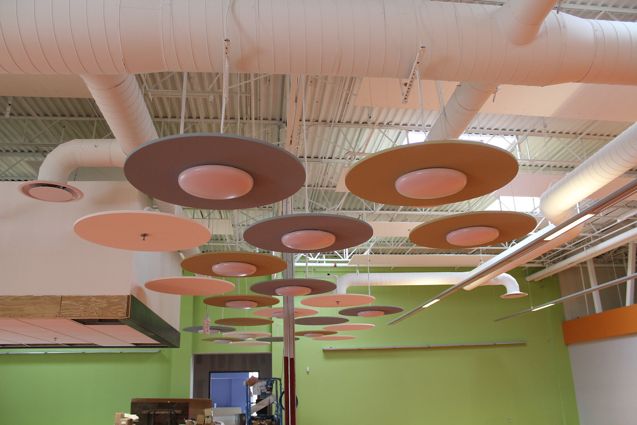 These circular light fixtures, which resemble mushrooms, lead to the children's programming room at the back of the children's section.