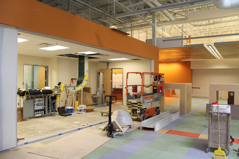 Right next to the entrance to the children's section is a view of the materials handling system, which is a high tech conveyor belt. When you return an item at the drive-up book drop (see picture a little later in this gallery), the materials handling system picks it up, transfers it to the circulation department, and sorts it for staff to re-shelve.