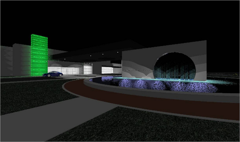 Exterior view of the main entrance and waterfall at night. The light tower will emit a series of colors throughout the night.