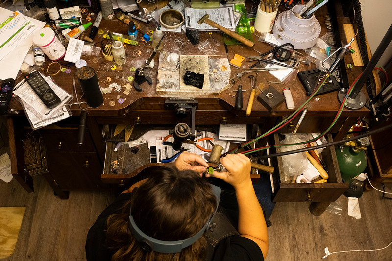 Molly Smith works through a custom order at the workbench she designed for herself in her store in Boonville, Mo., Thursday afternoon, Sept. 26, 2019.