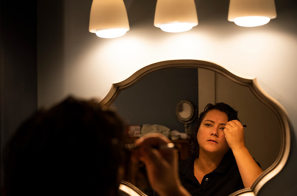 Molly Smith applies her makeup at home in New Franklin, Mo., before heading into Boonville to open her store, Molly's Jewelry Design, Thursday morning, Sept. 26, 2019.