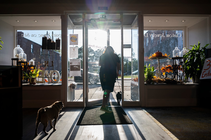 Molly Smith takes Mitzi outside for a break from her long list of custom jewelry orders as Midge watches them leave Wednesday afternoon, Sept. 25, 2019.