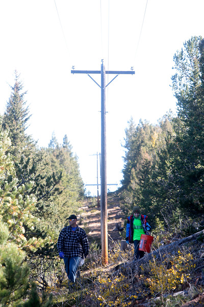David Falasca and his son Nihar, 8, walk along a path in Pike National Forest near Crystal Creek Reservoir on Sunday, Oct. 1, 2017. Volunteers tried to take different routes near the reservoirs to gather as much trash as possible.<br /> <br /> (The Gazette, Nadav Soroker)