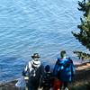 Eric Blohm, Kenny Blohm, 5, and Nihar Falasca, 8, walk along the shore of Crystal Creek Reservoir looking for trash on Sunday, Oct. 1, 2017.<br /> <br /> (The Gazette, Nadav Soroker)