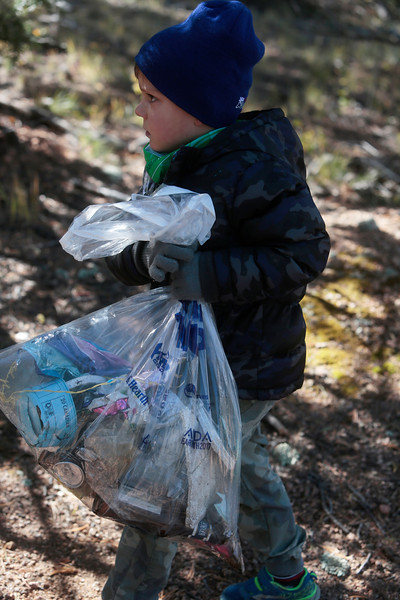 Kenny Blohm, 5, carries a bag of trash that he gathered on the shore of Crystal Creek Reservoir on Sunday, Oct. 1, 2017. <br /> <br /> (The Gazette, Nadav Soroker)