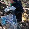 Kenny Blohm, 5, carries a bag of trash that he gathered on the shore of Crystal Creek Reservoir on Sunday, Oct. 1, 2017. <br /> <br /> (The Gazette, Nadav Soroker)