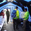 Search and rescue team-members work in the main tent at the staging area at the Catamount Recreation area on Monday, Oct. 2, 2017. About 60 volunteers have been searching for Micah Lambert since her car was discovered on Friday, covering areas as far as 7.5 miles away.
