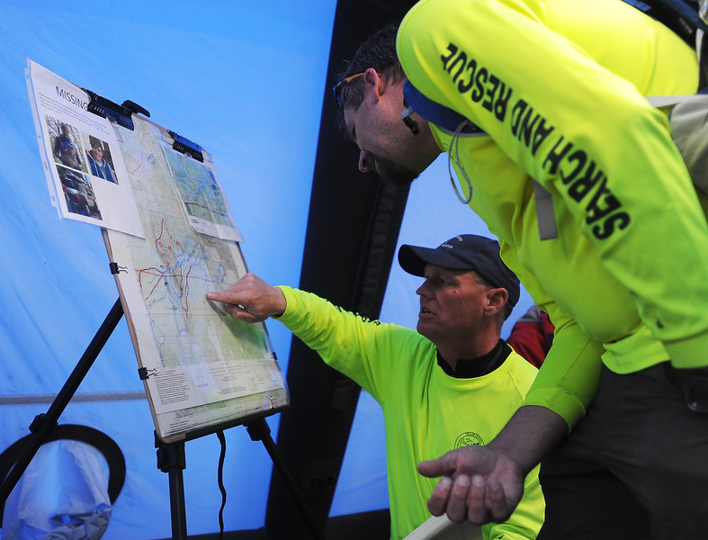 Don Johnson, the search and rescue mission coordinator, briefs a team-member on potential search locations in the staging area at the Catamount Recreation area on Monday, Oct. 2, 2017. The search and rescue teams started with Hasty Searches of high priority areas after Micah Lambert's car was found in the parking lot on Friday.