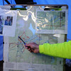 Don Johnson, the search and rescue mission coordinator goes over areas that have already been searched and where teams will focus next at the Catamount Recreation area on Monday, Oct. 2, 2017. After the initial Hasty Search of the immediate area around Micah Lambert's car the team expanded their search and went over areas in more detail.