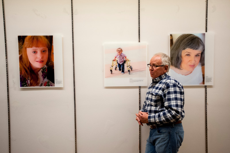 Garry Butcher, Director of Marketing at The Resource Exchange, stands among photos of local subjects living with disabilities at the Chapel Hills Mall event center on Tuesday, Oct. 3, 2017. Butcher is preparing for an event on Saturday that will bring the photo subjects and photographer together for a meet and greet open to the public.